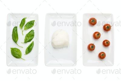 Italian food like flag, basil mozzarella tomato on white