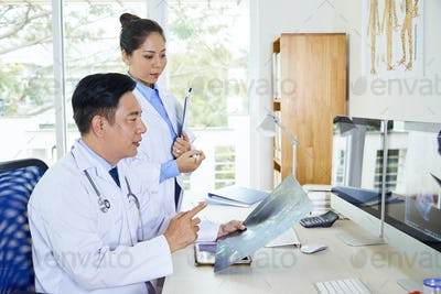 Two Asian Doctors Coworking