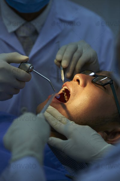 Dentists Doing Dental Surgery