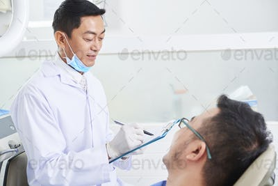 Asian Male Dentist At Work