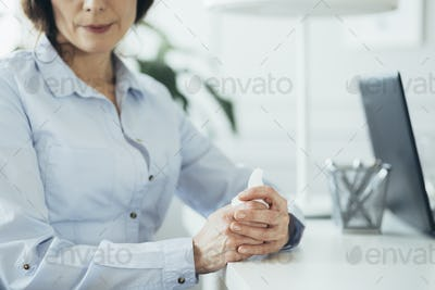 Woman siting at desk in therapy room