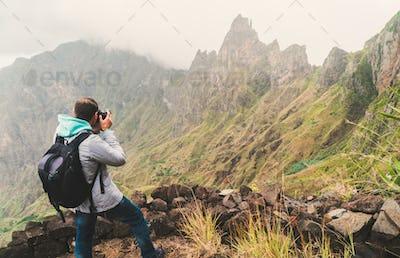 Santo Antao Island, Cape Verde. Male traveler photographing mountain peaks in surreal Xo Xo valley