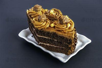 Chocolate cake. A slice of chocolate cake on a gray background