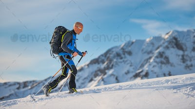 Uphill with skis and seal skins