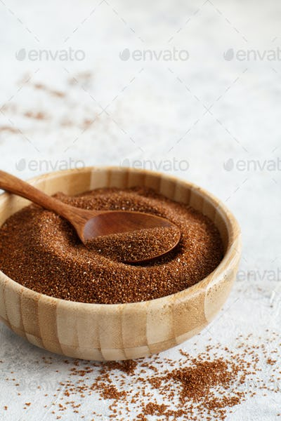 Teff grain in a bowl with a spoon