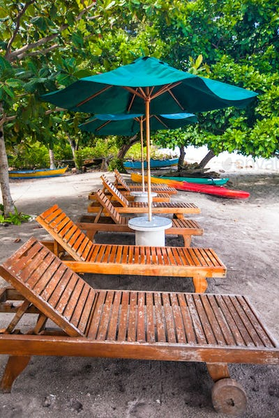 Beach wooden chairs for vacations on tropical plage