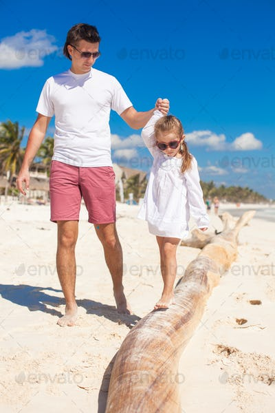 Family vacation on white beach