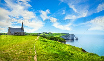Etretat village, Church and Aval cliff. Normandy, France.