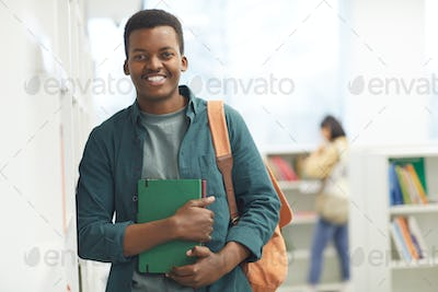 Smiling African Student Posing in Library