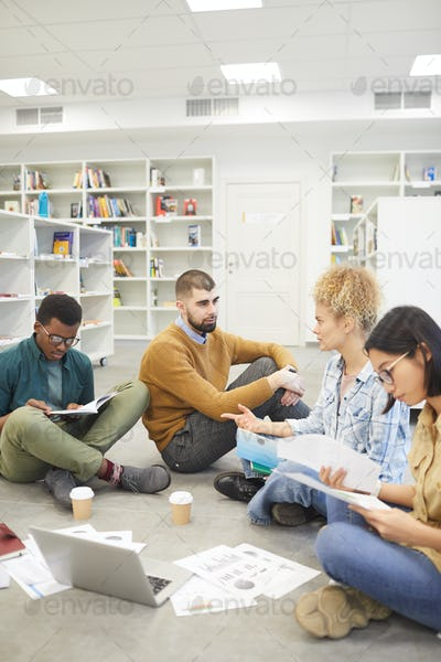 Young People Studying on Floor in Library