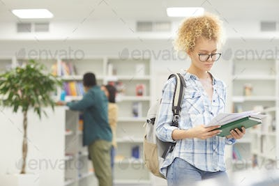 Young Woman In College Library