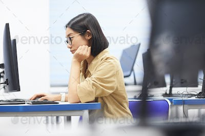 Asian Young Woman Using Computer in College