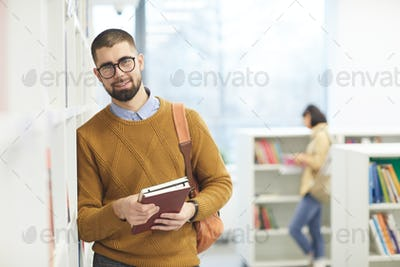 Smiling Adult Student Posing in Library