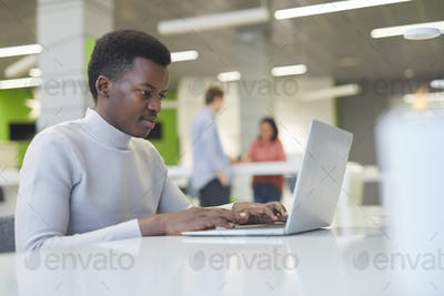 African-American Man Working in Open Office