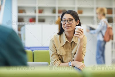 Smiling Asian Student in Library