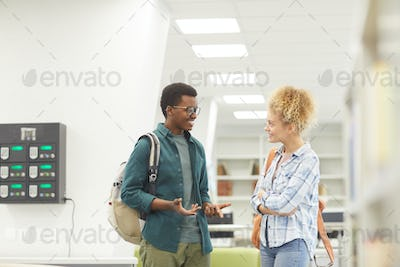 Two Students Chatting in College