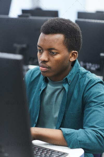 African Student Using Computer in College