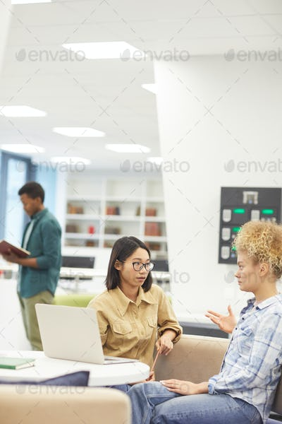 Two Young Women in Library