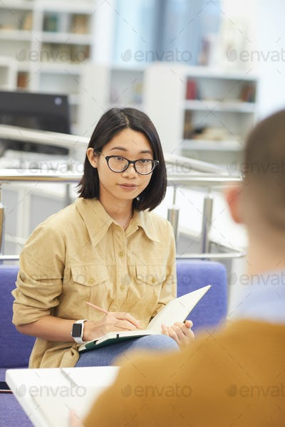 Asian Young Woman Studying with Partner