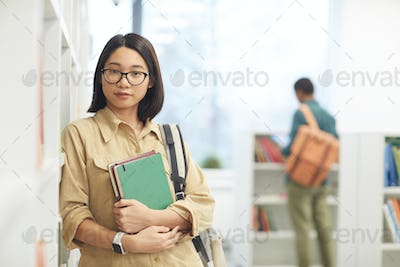 Asian Student Posing in Library