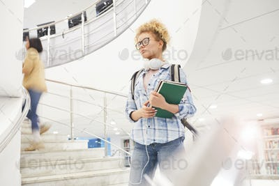 Young Woman Standing on Stairs in College