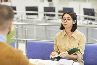 Young Asian Woman in Library