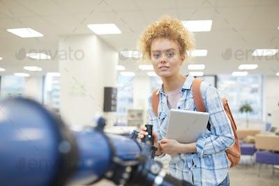 Female Student Posing with Telescope