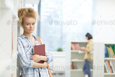 Female Student Posing in Library
