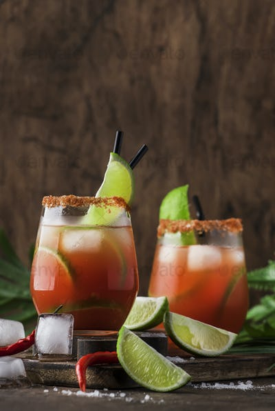 alcoholic cocktail with beer, lime juice, tomato juice, spicy sauce