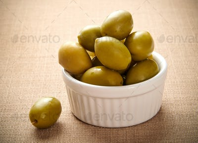 Small ceramic dish of fresh green giant olives