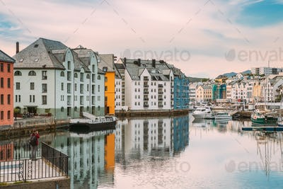 Alesund, Norway. Young Woman Tourist Traveler Photographer Taking Pictures Photos Of Old Wooden