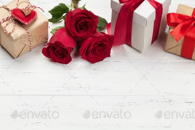 Valentines day card with gifts and flowers