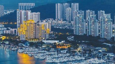 Haikou city with high modern buildings on Nandu River bank