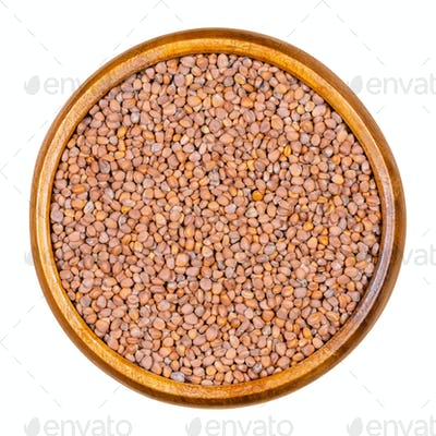 Rose radish seeds in wooden bowl