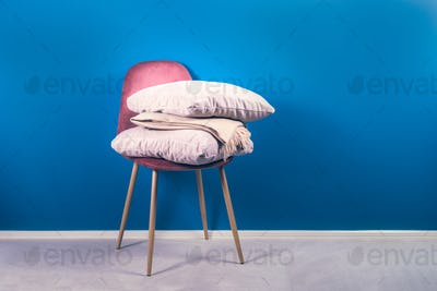 Modern Pink Velour Chair with Beige Cushions and Throw