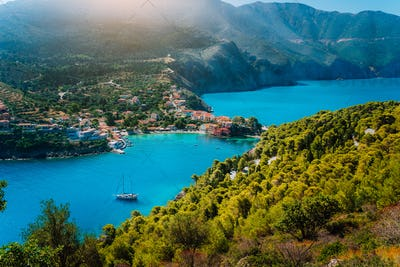 Panoramic view to Assos village Kefalonia. Greece. White lonely yacht in beautiful turquoise colored