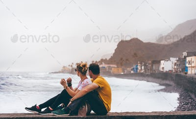 Santo Antao Island, Cape Verde. Couple in front of coastal town of Paul enjoying atlantic ocean