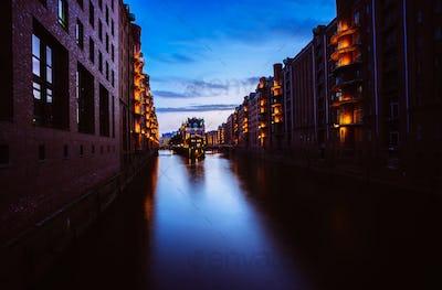 Blue hour in Warehouse District - Speicherstadt. Tourism landmark of Hamburg in twilight. View of