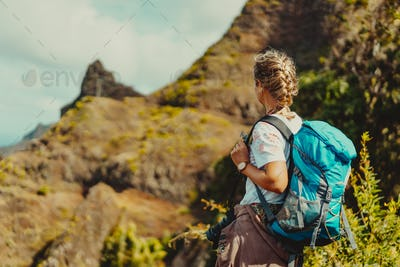 Santo Antao island, Cabo Verde. Woman tourist with backpack enjoy the view during the hike in arid