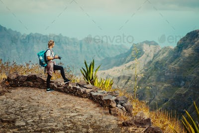 Santo Antao Island Cape Verde. Female tourist with backpack enjoying hiking path route view to