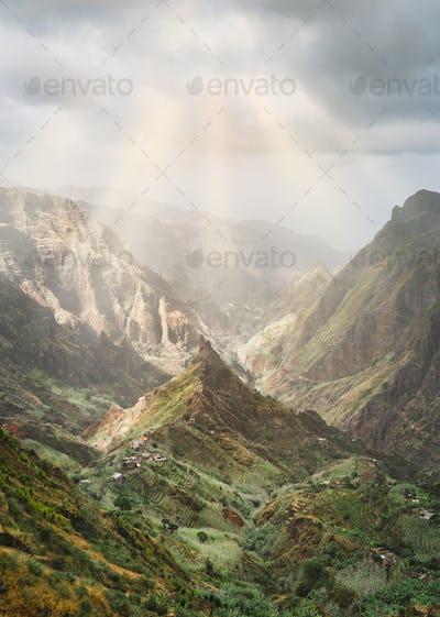 Mysterious sunrays shining on mountain peaks in Xo-Xo valley of Santa Antao island in Cape Verde