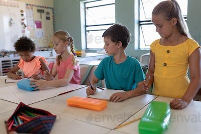 Group of schoolchildren working in an elementary school classroom