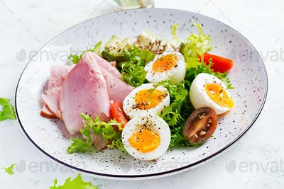Ketogenic/paleo diet. Boiled eggs, ham, avocado and fresh salad.  Keto breakfast. Brunch.