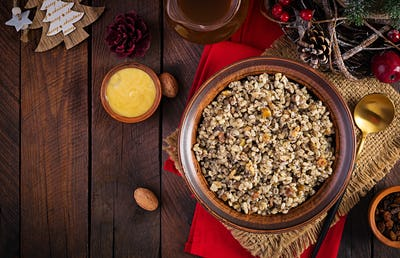 Christmas porridge made of wheat grains, poppy seed, nuts, raisins and honey