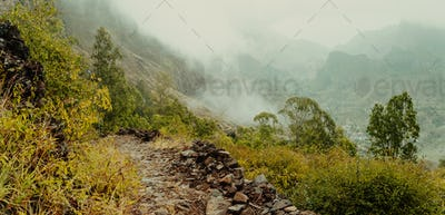 Panoramic view of a fertile Paul valley. Agriculture terraces in vertical valley sides, rugged peaks