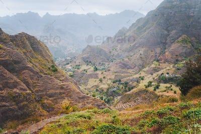 Vertiginous trekking trails leading between mountain hills down to the Coculi valley. Santo Antao
