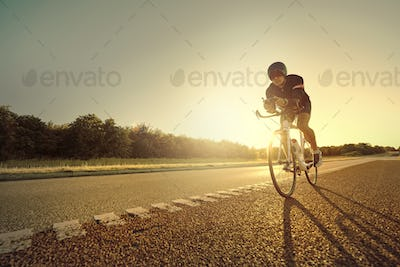 Man riding a bike in the evening