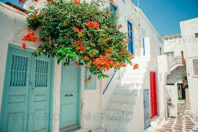 Traditional houses withe blue doors in the narrow streets of Mykonos, Greece