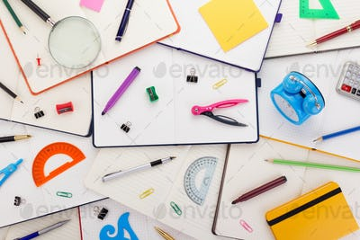 notepad or notebook with school supplies
