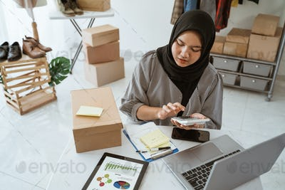 Dropshipping business owner working in her office
